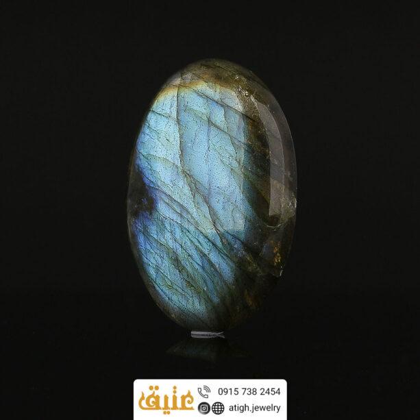 نگین لابرادوریت اصل درشت بازی رنگ بینظیر پر طاووسی تراش دامله | سایت جواهری عتیق: atigh.jewelry