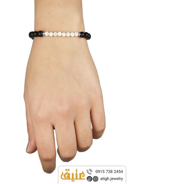 دستبند بافت صدف و عقیق سیاه (انیکس) معدنی و حدید مکعبی | سایت جواهری عتیق: atigh.jewelry